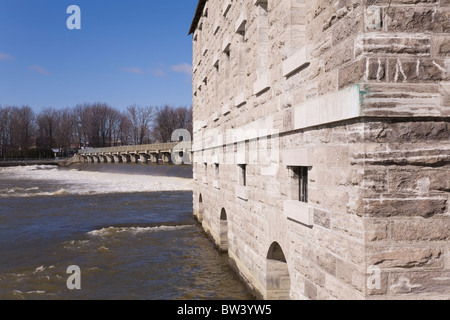 Partial view New Mill and Water Flow Control Dam on Mille-Iles River at Springtime, Old Terrebonne, Lanaudiere, - Stock Photo
