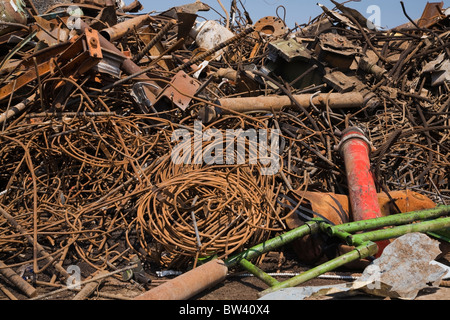 Pile of discarded rusted metal at a scrap metal recycling yard, Quebec, Canada - Stock Photo