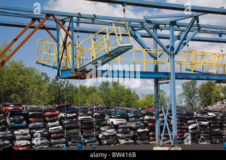 Crushed automobiles and shredder at a scrap metal recycling junkyard, Quebec, Canada - Stock Photo
