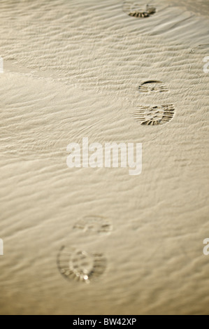 Footprints in the sand, Long Beach, Tofino, British Columbia, Canada - Stock Photo
