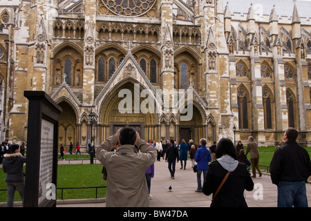 Tourist photographing Westminster Abbey in London England - Stock Photo