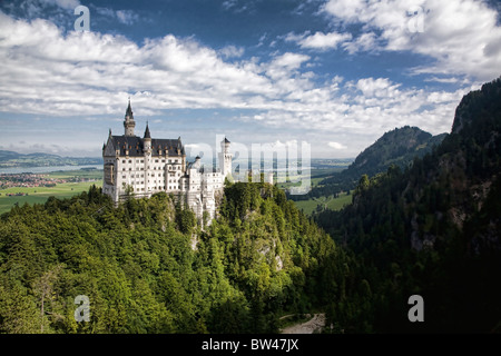 Neuschwanstein Castle overlooks the rolling hills in Bavaria, Germany. - Stock Photo