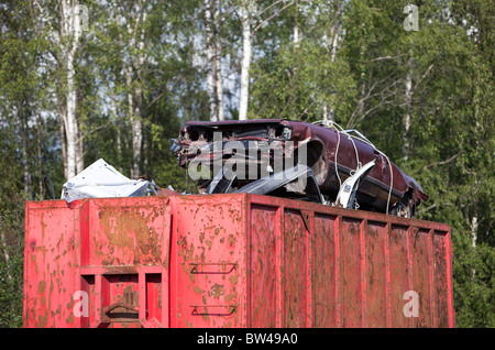 Full skip of metal waste waiting for recycling - Stock Photo
