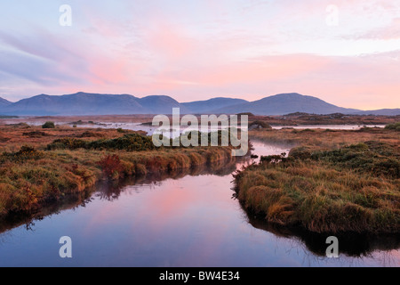 The Maumturk Mountains and the Invermore River, Connemara, County Galway, Connaught, Ireland. - Stock Photo