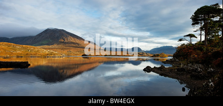 Derryclare Lough and Derryclare of the Twelve Pins, viewed from Canal Bridge, Connemara, County Galway, Connought, - Stock Photo