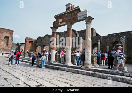 The entrance to the Macellum (market) in the North East of the Forum attracts many tourists, Pompeii, Italy - Stock Photo