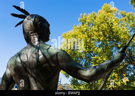Statue of a Native American outside the Tennessee Aquarium at Ross Landing Park, Chattanooga, Tennessee, USA - Stock Photo