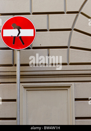 Road sign defaced by street artist Clet Abraham, Florence - Stock Photo
