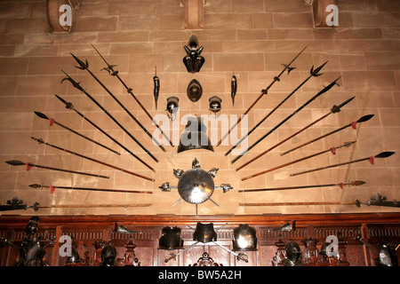 16th Century Swords and Armor on the wall in the Great Hall of Warwick Castle - Stock Photo