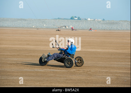Man with kite buggy on the beach at Westward Ho! Devon UK - Stock Photo