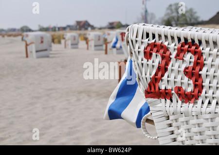 Beach chairs on the beach near Neustadt at Baltic Sea, Schleswig-Holstein, Germany - Stock Photo