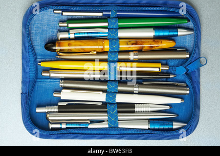 Collection of different pens placed in a blue pen-box - Stock Photo
