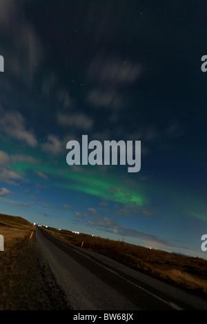 Aurora Borealis (Northern Lights) viewed  from outside Reykjavik, Iceland. - Stock Photo