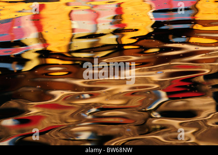 Abstract colourful reflection of Buildings in The River Cam, Cambridge, England, UK - Stock Photo