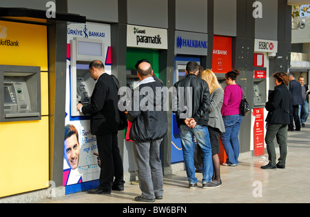 ISTANBUL, TURKEY. A row of cash machines by the ferry terminal in Uskudar district on the Asian side of the city. - Stock Photo