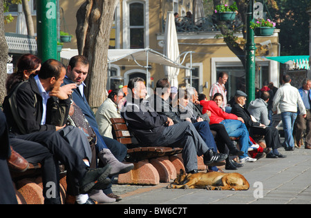 ISTANBUL, TURKEY. People relaxing on the Bosphorus waterfront at Ortakoy in Besiktas district. 2010. - Stock Photo