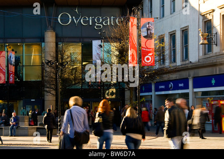 Blurred people walking about at the entrance to the Overgate Shopping Centre in Dundee on a sunny day,UK - Stock Photo