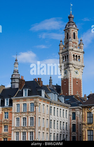 Tower of the Chambre de commerce and historic houses in Lille, France - Stock Photo