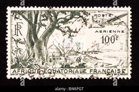 Postage stamp from French Equatorial Africa depicting a village and waterfront. - Stock Photo
