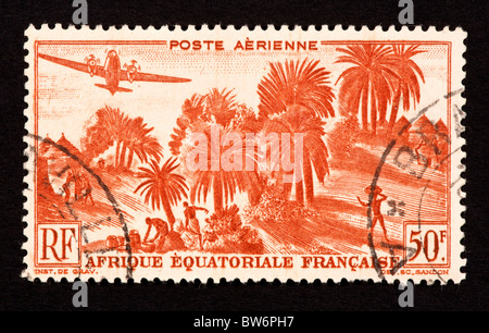 Postage stamp from French Equatorial Africa depicting palms and a village. - Stock Photo