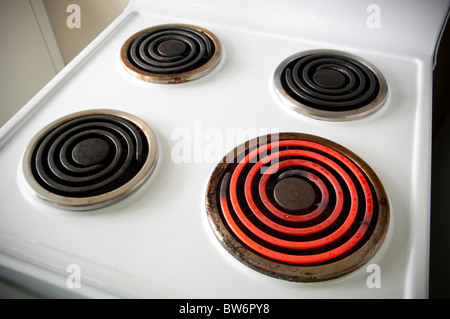 Four electric elements on a stove with one turned on - Stock Photo