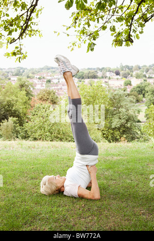 woman doing a headstand stock photo 21206897  alamy