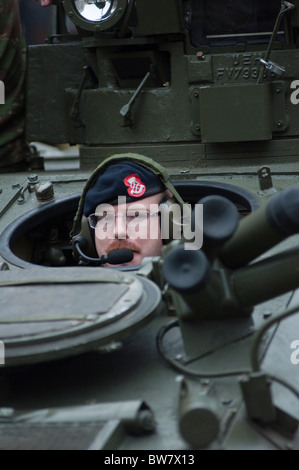 British tank commander in his vehicle - Stock Photo