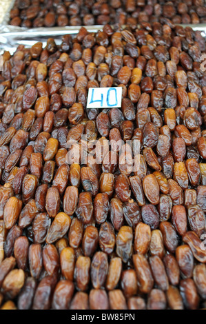 Marrakesh Morocco 2010 - Dates on sale at a stall in the famous Djemaa El-Fna market square in Marrakech - Stock Photo