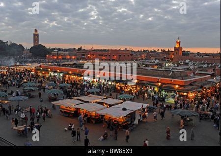 Marrakesh Morocco - The famous Djemaa El-Fna market square in Marrakech at dusk early evening - Stock Photo