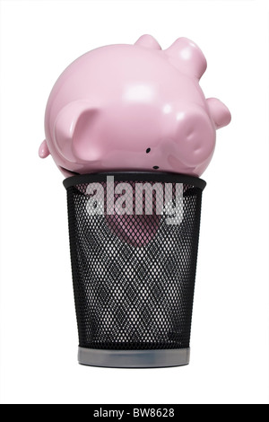 Piggy bank in a trash can - Stock Photo
