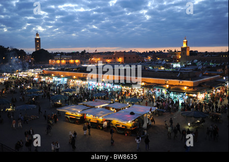 Marrakesh Morocco 2010 - The famous Djemaa El-Fna market square in Marrakech at dusk early evening - Stock Photo