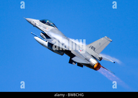 F-16AM Fighting Falcon jet fighter operated by the Royal Netherlands Air Force climbing with full afterburner after - Stock Photo