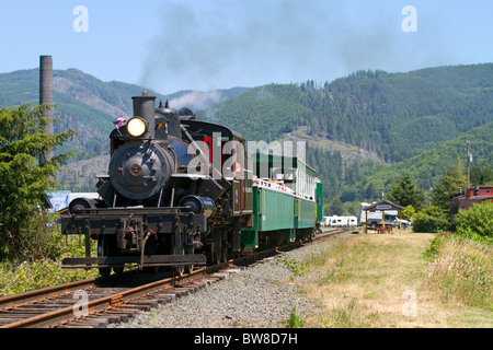 Tourists ride behind a 1910 Heisler Steam Locomotive at Garibaldi, Oregon, USA. - Stock Photo