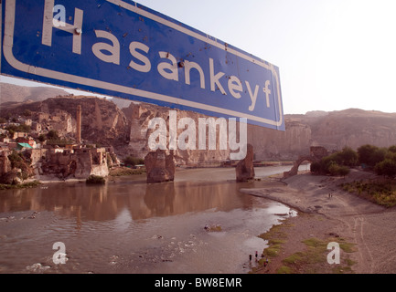 A view of the Tigris river and a road sign for the ancient Kurdish village of Hasankeyf in the eastern Anatolia - Stock Photo