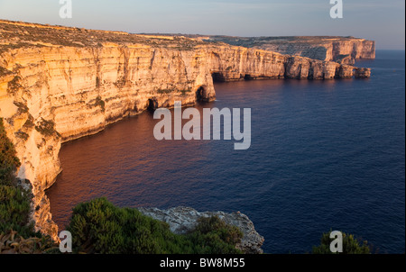 A sweep of cliffs rising more than a 100 metres above the sea girdle the west of Gozo in Malta. - Stock Photo