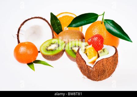 Fresh exotic fruits over white background - Stock Photo