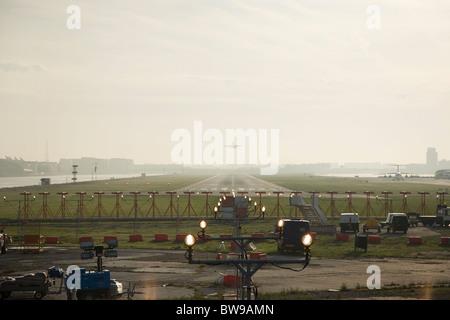 passenger jet taking off at London City Airport - Stock Photo