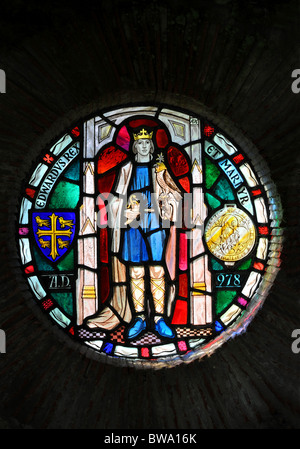 Stained glass window depicting King Edward The Martyr in the shrine which once housed his relics in the ruins of - Stock Photo