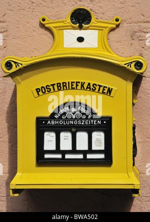 German yellow postbox photographed in Cochem,Rhineland-Palatinate, Germany - Stock Photo