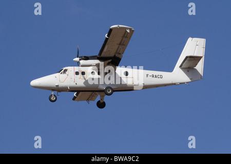De Havilland Canada DHC-6 Twin Otter light turboprop commuter plane in flight - Stock Photo