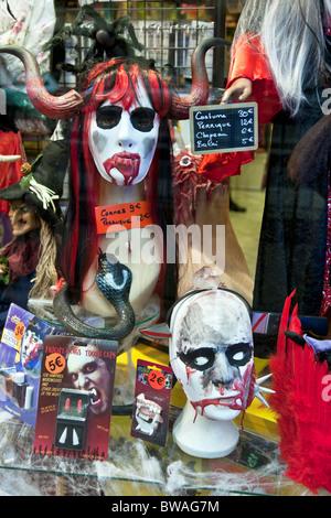 bizarre scary Halloween display of vampire & other paraphernalia in window of novelty joke shop Boulevard Saint - Stock Photo