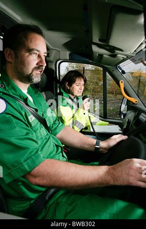 Driver and radio operator in ambulance - Stock Photo