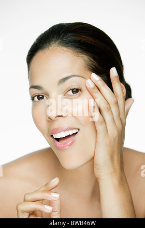 Woman touching her face - Stock Photo