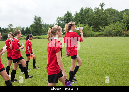 Girl soccer players on field - Stock Photo