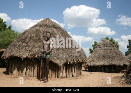 Painted Karo Tribe Man Standing Outside His Hut In The Omo Valley, Ethiopia - Stock Photo