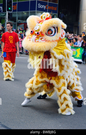 Southern Chinese-style lion dance being performed during the Chinese New Year parade; dancing lion; Chinese lion - Stock Photo