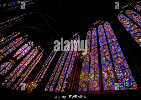 Stained glass windows depicting biblical scenes in Sainte-Chapelle - Stock Photo