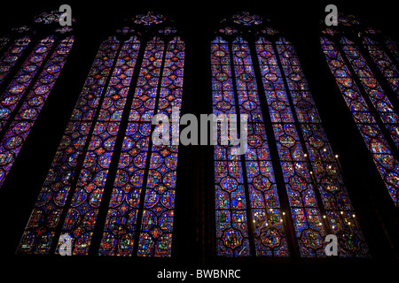 stained-glass windows depicting biblical scenes in Sainte-Chapelle - Stock Photo