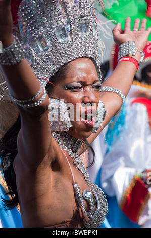 Showgirl with costume malfunction at the Notting Hill Carnival 2010, London, UK - Stock Photo