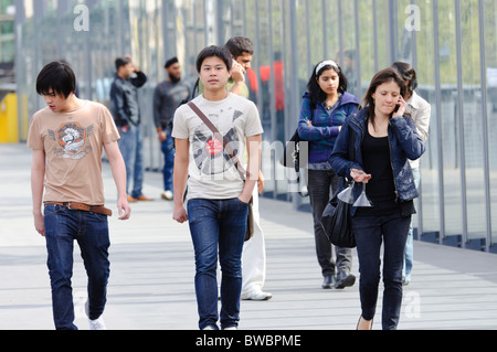 Young ethnic people walking.  International students, migrants, and/or Asian-Australians. - Stock Photo